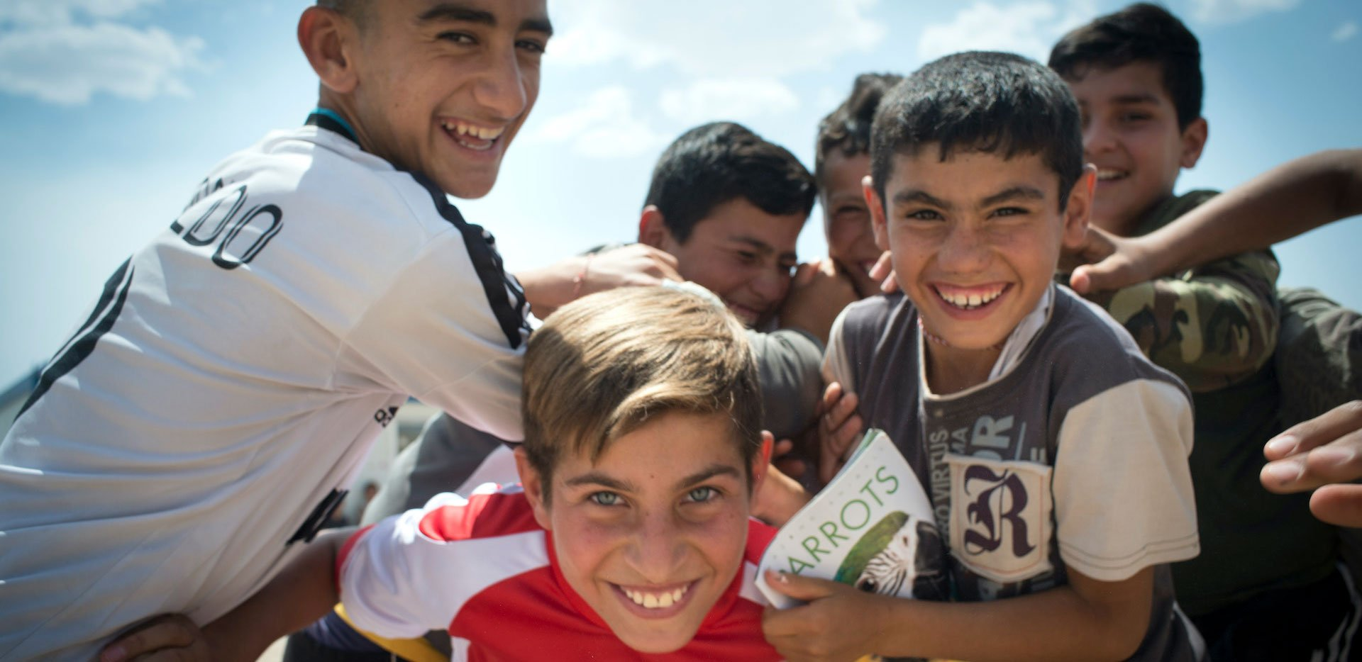 Boys playing in the Essyan Camp for Yazidi refugees